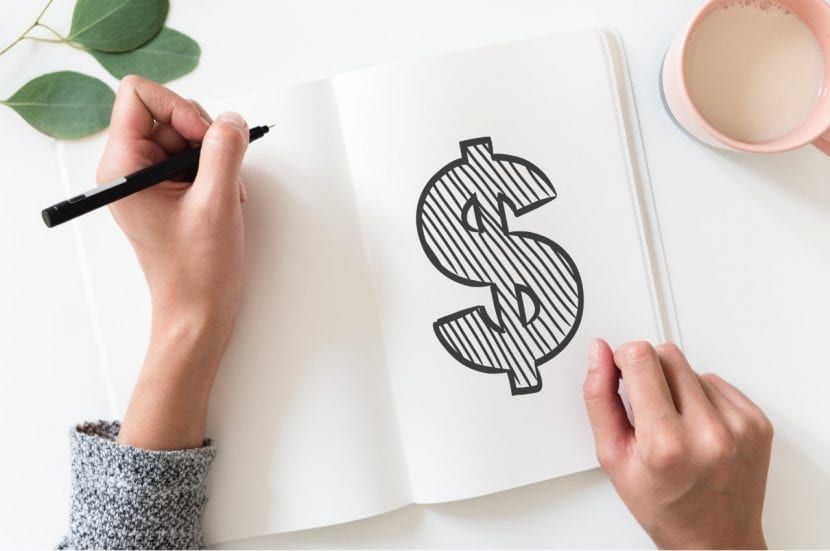 A lady has sketched a large dollar sign on a blank page of her notebook - Dollar Cost Averaging
