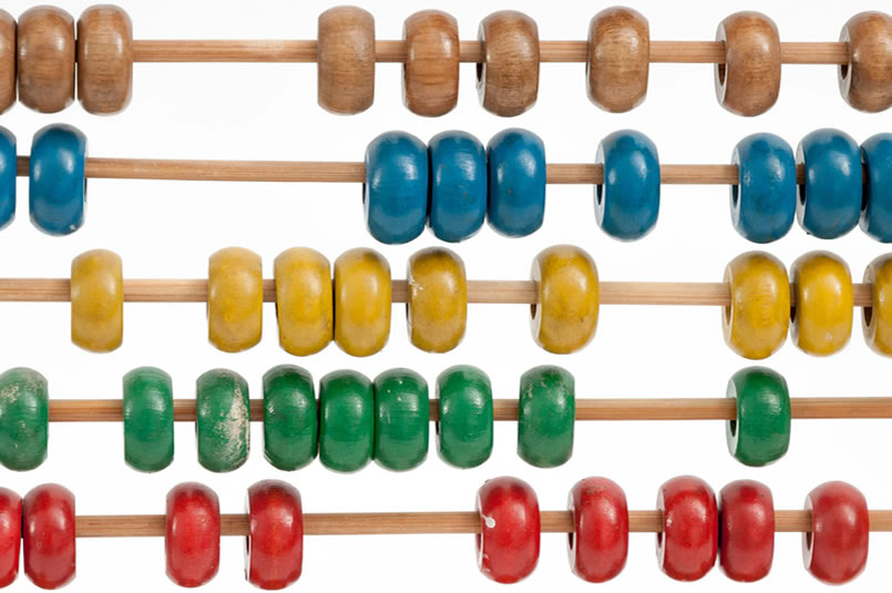 Financial Calculators & Resources: A close up of an abacus with colourful painted wooden beads.