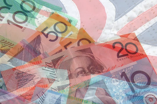 Composite image of Australian bank notes overlaying a waving Union Jack flag.